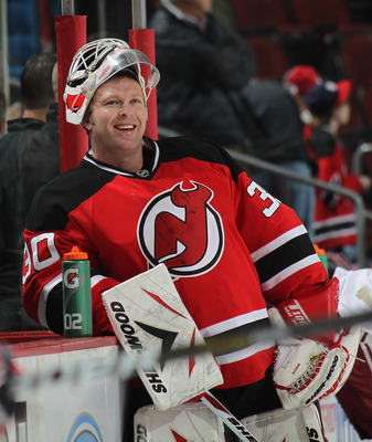 NEWARK, NJ - DECEMBER 15:  Goalie Martin Brodeur #30 of the New Jersey Devils enjoys a laugh during warmups before a hockey game against the Phoenix Coyotes at the Prudential Center on December 15, 2010 in Newark, New Jersey.  (Photo by Paul Bereswill/Get