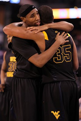 INDIANAPOLIS - APRIL 03:  Kevin Jones #5 and Wellington Smith #35 of the West Virginia Mountaineers hug after losing to the Duke Blue Devils during the National Semifinal game of the 2010 NCAA Division I Men's Basketball Championship at Lucas Oil Stadium