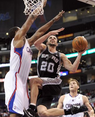 LOS ANGELES, CA - DECEMBER 01:  Manu Ginobili #20 of the San Antonio Spurs drives on DeAndre Jordan #9 of the Los Angeles Clippers during the game at the Staples Center on December 1, 2010 in Los Angeles, California.  NOTE TO USER: User expressly acknowle
