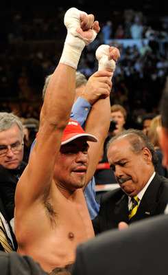 LAS VEGAS - JULY 31:  WBA/WBO lightweight champion Juan Manuel Marquez celebrates his unanimous-decison victory over Juan Diaz at the Mandalay Bay Events Center July 31, 2010 in Las Vegas, Nevada.  (Photo by Ethan Miller/Getty Images)