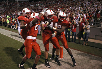 RALEIGH, NC - OCTOBER 28:  George Bryan #84 of the North Carolina State Wolfpack celebrates with teammates after a game winning touchdown and defeating the Florida State Seminoles 28-24 during their game at Carter-Finley Stadium on October 28, 2010 in Ral