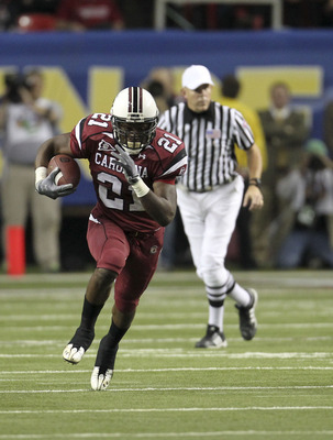 ATLANTA - DECEMBER 4:  Running back Marcus Lattimore #21 of the South Carolina Gamecocks runs with the ball during the 2010 SEC Championship against the Auburn Tigers at Georgia Dome on December 4, 2010 in Atlanta, Georgia. (Photo by Mike Zarrilli/Getty I