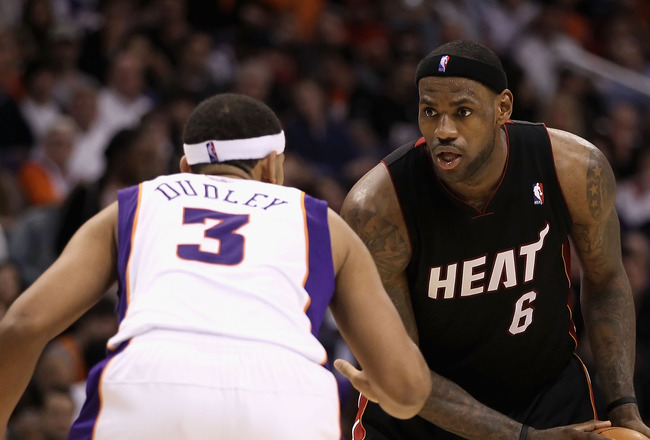 PHOENIX - DECEMBER 23:  LeBron James #6 of the Miami Heat looks to pass around Jared Dudley #3 of the Phoenix Suns during the NBA game at US Airways Center on December 23, 2010 in Phoenix, Arizona. The Heat defeated the Suns 95-83.  NOTE TO USER: User exp