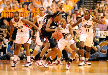 TAMPA, FL - APRIL 06:  Candice Wiggins #11 of the Stanford Cardinal drives against Lorin Dixon #30 of the UCONN Huskies during their National Semifinal Game of the 2008 NCAA Women's Final Four at St. Pete Times Forum April 6, 2008 in Tampa, Florida.  (Pho