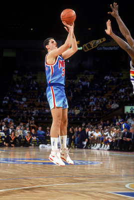 DENVER - 1990-91:  Drazen Petrovic #3 of the New Jersey Nets shoots a jumper against the Denver Nuggets during a 1990-91 season game at McNichols Arena in Denver, Colorado. NOTE TO USER: User expressly acknowledges and agress that, by downloading and or u