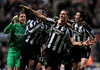 NEWCASTLE UPON TYNE, ENGLAND - DECEMBER 11:  Andy Carroll of Newcastle United celebrates scoring his team's third goal with his team mates during the Barclays Premier League match between Newcastle United and Liverpool at St James' Park on December 11, 20