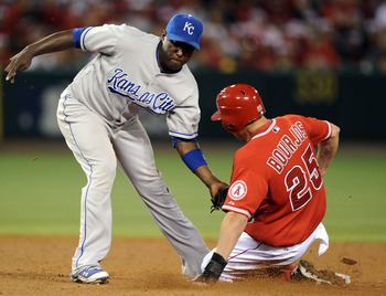 ANAHEIM, CA - AUGUST 10:  Yuniesky Betancourt #3 of the Kansas City Royals puts a tag on Peter Bourjos #25 of the Los Angeles for an out during the fifth inning at Angel Stadium on August 10, 2010 in Anaheim, California.  (Photo by Harry How/Getty Images)