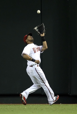 PHOENIX - SEPTEMBER 21:  Outfielder Chris Young #24 of the Arizona Diamondbacks catches a fly ball out against the Colorado Rockies during the Major League Baseball game at Chase Field on September 21, 2010 in Phoenix, Arizona.  (Photo by Christian Peters