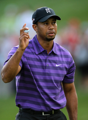 THOUSAND OAKS, CA - DECEMBER 02:  Tiger Woods holds up his ball after finishing his round on the 18th green during the Chevron World Challenge at Sherwood Country Club on December 2, 2010 in Thousand Oaks, California.  (Photo by Stephen Dunn/Getty Images)