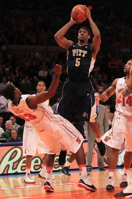 NEW YORK - NOVEMBER 18:  Gilbert Brown #5 of the Pittsburgh Panthers charges into Dino Gregory #33 of the Maryland Terrapins during the 2k Sports Classic at Madison Square Garden on November 18, 2010 in New York, New York.  (Photo by Chris McGrath/Getty I