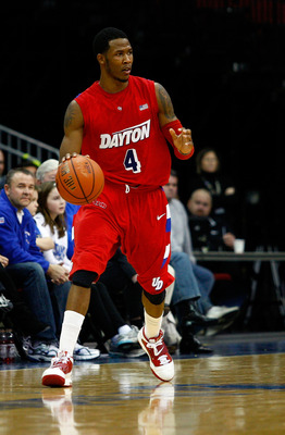NEWARK, NJ - DECEMBER 22:  Chris Johnson #4 of the Dayton Flyers moves the ball against the Seton Hall Pirates at Prudential Center on December 22, 2010 in Newark, New Jersey. Dayton won 69-65. (Photo by Chris Chambers/Getty Images)