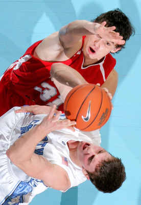 CHAPEL HILL, NC - DECEMBER 19:  Tyler Hansbrough #50 of the North Carolina Tar Heels shoots over Anatoly Bose #31 of the Nicholls State Colonels during the second half at the Dean E. Smith Center on December 19, 2007 in Chapel Hill, North Carolina.  North