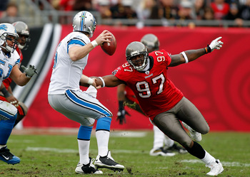 TAMPA, FL - DECEMBER 19:  Defensive end Alex Magee #97 of the Tampa Bay Buccaneers closes in on quarterback Drew Stanton #5 of the Detroit Lions during the game at Raymond James Stadium on December 19, 2010 in Tampa, Florida.  (Photo by J. Meric/Getty Ima