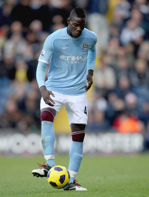 WEST BROMWICH, ENGLAND - NOVEMBER 07: Manchester City's Mario Balotelli in action during the Barclays Premier League match between West Bromwich Albion and Manchester City at The Hawthorns on November 7, 2010 in West Bromwich, England.  (Photo by Scott He