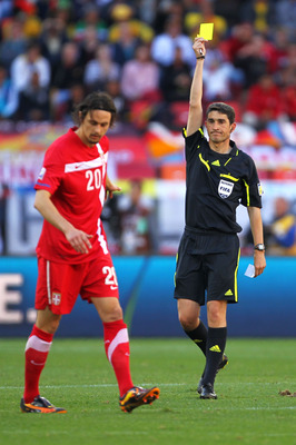 PORT ELIZABETH, SOUTH AFRICA - JUNE 18:  Neven Subotic of Serbia receives a yellow card from Referee Alberto Undiano during the 2010 FIFA World Cup South Africa Group D match between Germany and Serbia at Nelson Mandela Bay Stadium on June 18, 2010 in Por