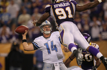 MINNEAPOLIS - SEPTEMBER 26:  Quarterback Shaun Hill #14 of the Detroit Lions is pressured by Ray Edwards #91 of the Minnesota Vikings during the second half at Hubert H. Humphrey Metrodome on September 26, 2010 in Minneapolis, Minnesota.  The Vikings defe