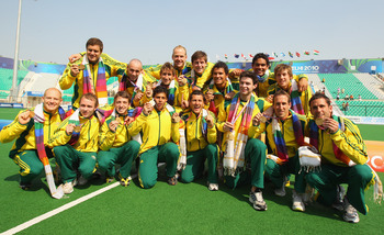 DELHI, INDIA - OCTOBER 14:  The Australian team pose with their gold medals after winning the Men's Gold medal match between Australia and India at the Major Dhyan Chand National Stadium during day eleven of the Delhi 2010 Commonwealth Games on October 14