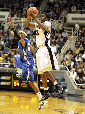 WEST LAFAYETTE, IN - DECEMBER 21:  E ' Twaun Moore #33 of the Purdue Boilermakers grabs a loose ball while defended by Jeremy Mixon #22 of the IPFW Mastodons during the game at Mackey Arena on December 21, 2010 in West Lafayette, Indiana.  (Photo by Andy