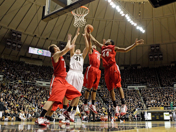 WEST LAFAYETTE, IN - JANUARY 12:  Kyle Madsen #15, Evan Turner #21 and  William Buford #44 of the Ohio State Buckeyes and Patrick Bade #41of the Purdue Boilermakers reach for a rebound during the Big Ten game at Mackey Arena on January 12, 2010 in West La