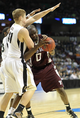 SPOKANE - MARCH 21:  Bryan Davis #0 of the Texas A&M  Aggies drives against Patrick Bade #41 of the Purdue Boilermakers during the second round of the 2010 NCAA men's basketball tournament at the Spokane Arena on March 21, 2010 in Spokane, Washington. (Ph