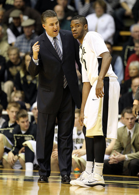 WEST LAFAYETTE, IN - DECEMBER 21:  Matt Painter the Head coach of the Purdue Boilermakers gives instructions to Kelsey Barlow #12 during the game against the IPFW Mastodons at Mackey Arena on December 21, 2010 in West Lafayette, Indiana.  (Photo by Andy L