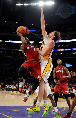 LOS ANGELES, CA - DECEMBER 25:  Dwayne Wade #3 of the Miami Heat puts a shot up against Pau Gasol #16 of the Los Angeles Lakers at Staples Center on December 25, 2010 in Los Angeles, California. NOTE TO USER: User expressly acknowledges and agrees that, b