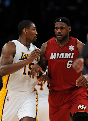 LOS ANGELES, CA - DECEMBER 25:  Ron Artest #15 of the Los Angeles Lakers and LeBron James #6 of the Miami Heat run upcourt during the game at Staples Center on December 25, 2010 in Los Angeles, California. NOTE TO USER: User expressly acknowledges and agr