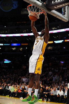 LOS ANGELES, CA - DECEMBER 25:  Lamar Odom #7 of the Los Angeles Lakers slam dunks the ball against the Miami Heat at Staples Center on December 25, 2010 in Los Angeles, California. NOTE TO USER: User expressly acknowledges and agrees that, by downloading