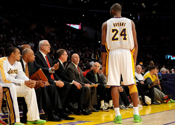 LOS ANGELES, CA - DECEMBER 25:  Kobe Bryant #24 talks with head coach Phil Jackson of the Los Angeles Lakers during the game against the Miami Heat at Staples Center on December 25, 2010 in Los Angeles, California. NOTE TO USER: User expressly acknowledge