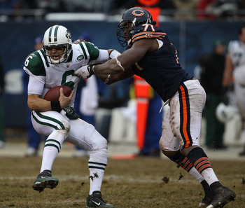 CHICAGO, IL - DECEMBER 26: Mark Sanchez #6 of the New York Jets tries to escape from Israel Idonije #71 of the Chicago Bears at Soldier Field on December 26, 2010 in Chicago, Illinois. The Bears defeated the Jets 38-34. (Photo by Jonathan Daniel/Getty Ima