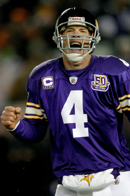 MINNEAPOLIS, MN - DECEMBER 20:  Quarterback Brett Favre of the Minnesota Vikings celebrates the Vikings first touchdown against the Chicago Bears at TCF Bank Stadium on December 20, 2010 in Minneapolis, Minnesota.  (Photo by Matthew Stockman/Getty Images)