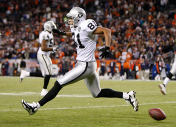DENVER - DECEMBER 20:  Chaz Schilens #81 of the Oakland Raiders celebrates after scoring a touchdown late in the fourth quarter against the Denver Broncos at Invesco Field at Mile High on December 20, 2009 in Denver, Colorado. The Raiders defeated the Bro