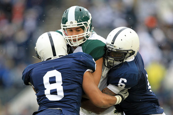 STATE COLLEGE, PA - NOVEMBER 27: Tight end Brian Linthicum #88 of the Michigan State Spartans is tackled by cornerback D'Anton Lynn #8 and linebacker Gerald Hodges #6 of the Penn State Nittany Lions during a game on November 27, 2010 at Beaver Stadium in