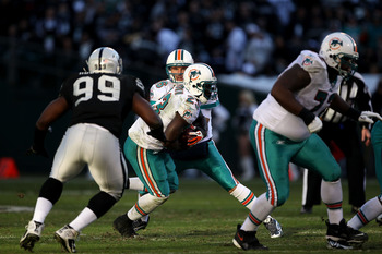 OAKLAND, CA - NOVEMBER 28:  Chad Henne #7 of the Miami Dolphins hands off to Ronnie Brown during their game against the Oakland Raiders at Oakland-Alameda County Coliseum on November 28, 2010 in Oakland, California.  (Photo by Ezra Shaw/Getty Images)