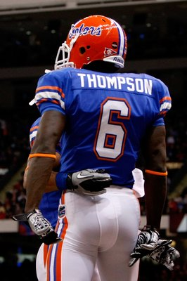 NEW ORLEANS - JANUARY 01:  Deonte Thompson #6 of the Florida Gators celebrates with his teammate Emmanuel Moody #21 after scoring a touchdown against the Cincinnati Bearcats during the Allstate Sugar Bowl at the Louisana Superdome on January 1, 2010 in Ne