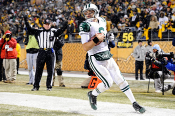 PITTSBURGH, PA - DECEMBER 19:  Mark Sanchez #6 of the New York Jets runs for a touchdown during the game against Pittsburgh Steelers at Heinz Field on December 19, 2010 in Pittsburgh, Pennsylvania.  (Photo by Karl Walter/Getty Images)