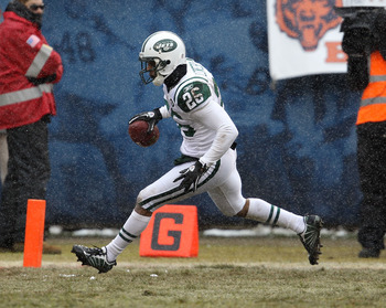 CHICAGO, IL - DECEMBER 26: Dwight Lowery #26 of the New York Jets crosses into the end zone after interceptiong a pass for a touchdown against the Chicago Bearsat Soldier Field on December 26, 2010 in Chicago, Illinois. The Bears defeated the Jets 38-34.