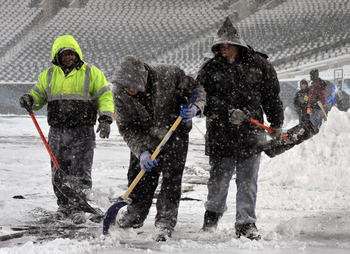 PHILADELPHIA - DECEMBER 26: Personnel work to remove snow at Lincoln Financial Field on December 26, 2010 in Philadelphia, Pennsylvania. The game between the Minnesota Vikings and Philadelphia Eagles was postponed by the NFL.(Photo by Drew Hallowell/Getty