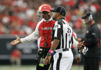 ATLANTA - OCTOBER 03:  Line judge Adrian Hill #29 and head coach Mike Singletary of the San Francisco 49ers against the Atlanta Falcons at Georgia Dome on October 3, 2010 in Atlanta, Georgia.  (Photo by Kevin C. Cox/Getty Images)