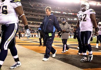 CINCINNATI - DECEMBER 26:  Norv Turner (center) the Head Coach of the San Diego Chargers walks off of the field following the Chargers 34-20 loss to the Cincinnati Bengals during the NFL game at Paul Brown Stadium on December 26, 2010 in Cincinnati, Ohio.