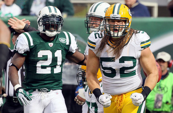 EAST RUTHERFORD, NJ - OCTOBER 31:  Clay Matthews #52 of the Green Bay Packers celebrates a play as LaDainian Tomlinson #21 of the New York Jets looks on on October 31, 2010 at the New Meadowlands Stadium in East Rutherford, New Jersey.  (Photo by Jim McIs