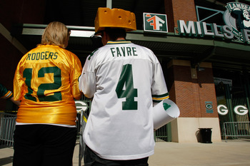 GREEN BAY, WI - AUGUST 11: Fans of Aaron Rogers along with a Brett Favre fan wear their respective jerseys as the enter  Lambeau Field prior to the game between the Green Bay Packers against the Cincinnati Bengals at the Lambeau Field on August 11, 2008 i