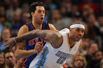 DENVER - NOVEMBER 16:  Carmelo Anthony #15 of the Denver Nuggets fights for position with Landry Fields #6 of the New York Knicks at the Pepsi Center on November 16, 2010 in Denver, Colorado. NOTE TO USER: User expressly acknowledges and agrees that, by d