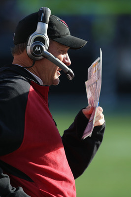 CHARLOTTE, NC - DECEMBER 19:  Head coach Ken Whisenhunt of the Arizona Cardinals calls a play against the Carolina Panthers during their game at Bank of America Stadium on December 19, 2010 in Charlotte, North Carolina.  (Photo by Streeter Lecka/Getty Ima