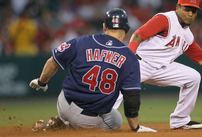 ANAHEIM, CA - SEPTEMBER 06:  Travis Hafner #48 of the Cleveland Indians slides into second with a double  as shortstop Erick Aybar #2 of the Los Angeles Angels of Anaheim takes the throw in the fourth inning on September 6, 2010 at Angel Stadium in Anahei