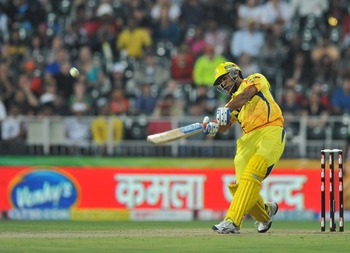 JOHANNESBURG, SOUTH AFRICA - SEPTEMBER 26: Mahendra Singh Dhoni of the Super Kings hits another six during the 2010 Airtel Champions League Twenty20 final match between Chennai Super Kings and Chevrolet Warriors from Bidvest Wanderers Stadium on September