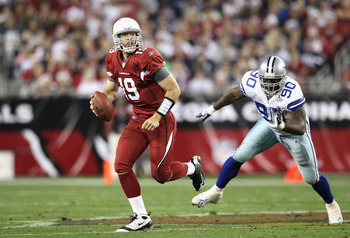 GLENDALE, AZ - DECEMBER 25:  Quarterback John Skelton #19 of the Arizona Cardinals scrambles with the ball past Jay Ratliff #90 of the Dallas Cowboys during the NFL game at the University of Phoenix Stadium on December 25, 2010 in Glendale, Arizona. The C