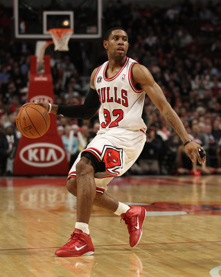 CHICAGO, IL - DECEMBER 21: C.J. Watson #32 of the Chicago Bulls looks to pass against the Philadelphia 76ers at the United Center on December 21, 2010 in Chicago, Illinois. The Bulls defeated the 76ers 121-76. NOTE TO USER: User expressly acknowledges and
