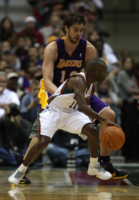 MILWAUKEE - NOVEMBER 16: Earl Boykins #11 of the Milwaukee Bucks dribbles around Pau Gasol #16 of the Los Angeles Lakers at the Bradley Center on November 16, 2010 in Milwaukee, Wisconsin. The Lakers defeated the Bucks 118-107. NOTE TO USER: User expressl