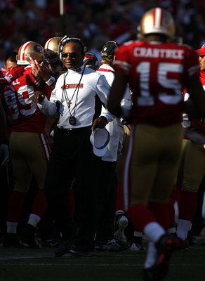 SAN FRANCISCO - NOVEMBER 08:  Head coach Mike Singletary of the San Francisco 49ers looks on with Michael Crabtree #15 against the Tennessee Titans during an NFL game on November 8, 2009 at Candlestick Park in San Francisco, California.  (Photo by Jed Jac